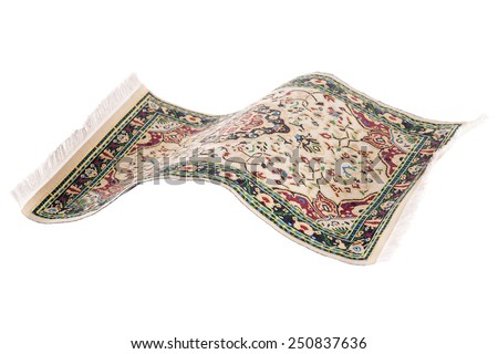 Magic flying persian carpet isolated on a white background with tassels - stock photo