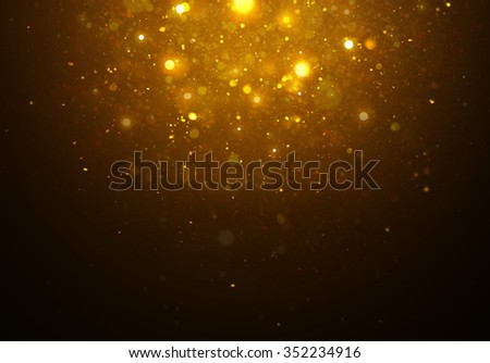Magic golden light on black background