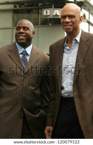 Magic Johnson and Kareem Abdul-Jabbar at the Ceremony Honoring Los Angeles Lakers Owner Jerry Buss with the 2,323rd star on the Hollywood Walk of Fame. Hollywood Boulevard, Hollywood, CA. 10-30-06 - stock photo