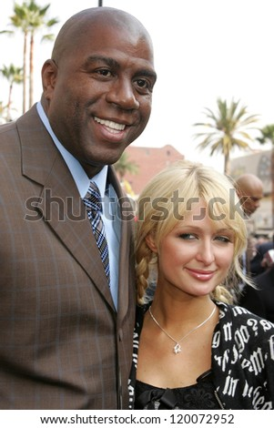 Magic Johnson and Paris Hilton at the Ceremony Honoring Los Angeles Lakers Owner Jerry Buss with the 2,323rd star on the Hollywood Walk of Fame. Hollywood Boulevard, Hollywood, CA. 10-30-06 - stock photo