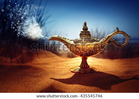 Magic lamp in the desert from the story of Aladdin with Genie appearing in blue smoke concept for wishing, luck and magic - stock photo