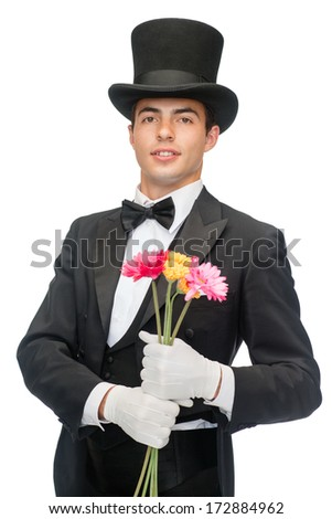 magic, performance, circus, show concept - magician with flowers - stock photo