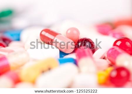 Magic pills isolated on white background - stock photo