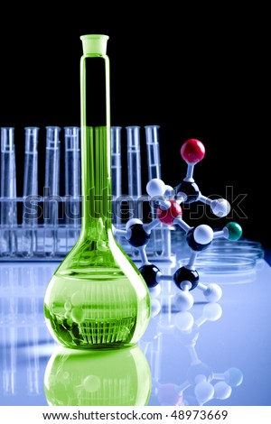 magic potion in laboratory, molecules in background - stock photo
