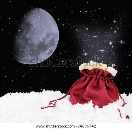 Magic satin sack on snow - stock photo