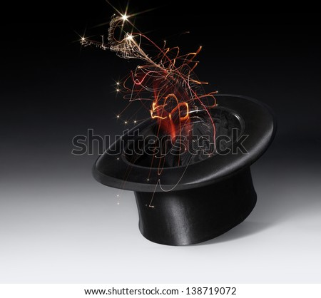 magic scenery with a black top hat and magic firework in gradient back - stock photo
