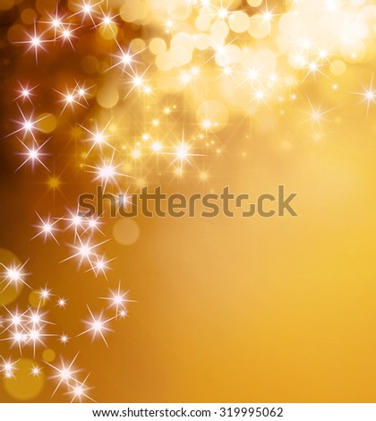Magic shiny gold background with star lights raining down