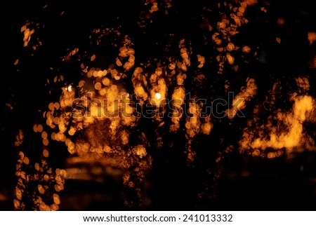 Magic sparkle, light dots on dark background with copy space - stock photo