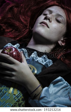 Magic, Teen with a red apple lying, tale scene - stock photo