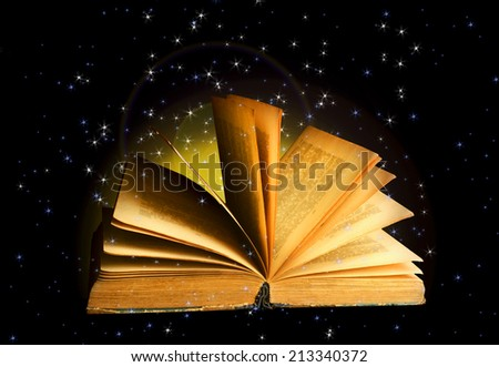 Magical book on dark background