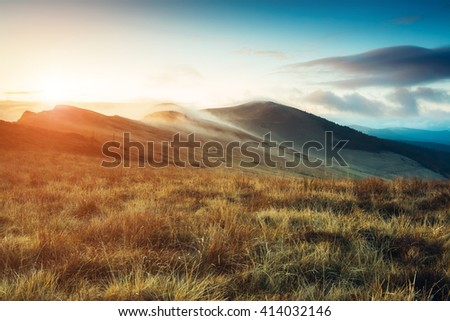 Magical hills glowing by sunlight at twilight. Dramatic scene and picturesque picture. Location place Carpathian, Ukraine, Europe. Beauty world. Retro and vintage style. Instagram toning effect. - stock photo