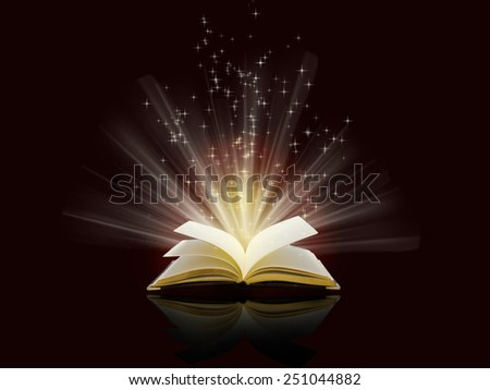 magical sparks fly from  open book - stock photo