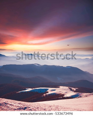 Magical winter landscape in the mountains at dawn