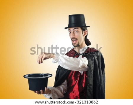Magician doing tricks on white - stock photo