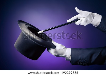 Magician hand with magic wand and hat - stock photo