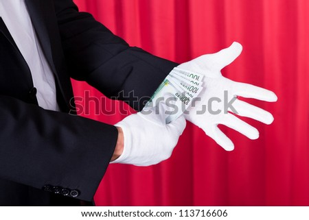 Magician Removing 100 Euro Note From Hand - stock photo