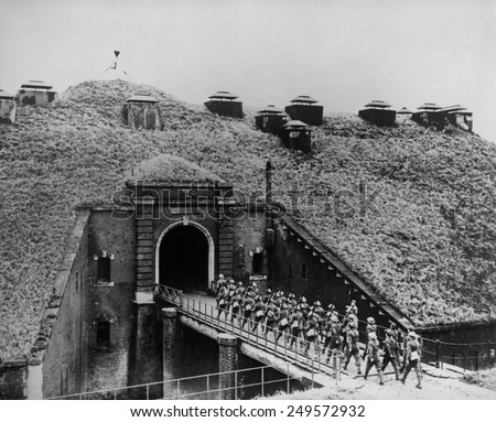 Maginot Line, on the French-German border, Dec. 1939. British troops march over bridge into the French underground fortress covered with vegetation. Fall 1940, in the first months of World War 2. - stock photo