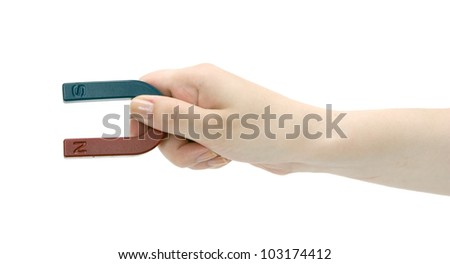 Magnet in a female hand on a white background. - stock photo