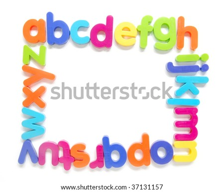 magnetic alphabet letters forming a frame - stock photo
