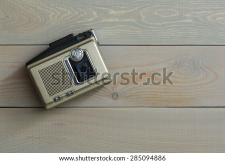 Magnetic audio tape cassette recorder on a wooden background - stock photo