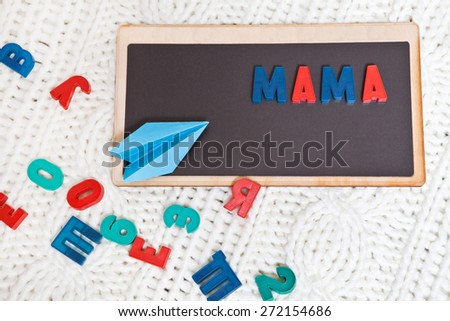 """Magnetic Board with the written word """"mother"""" in Russian - stock photo"""