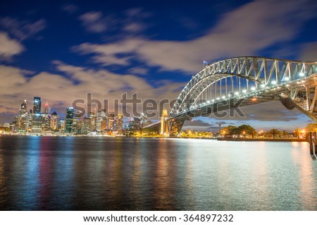 Magnificence of Sydney Harbour Bridge at dusk. - stock photo