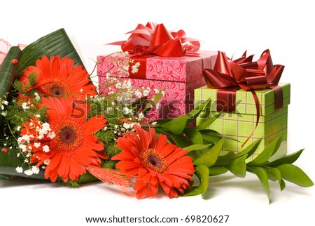 Magnificent bouquet gerbera and present boxes on a white - stock photo