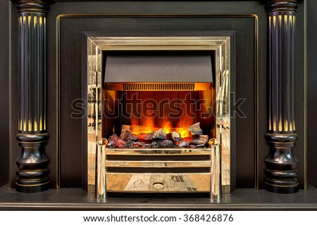 Magnificent fireplace with the artificial beautiful burning fire