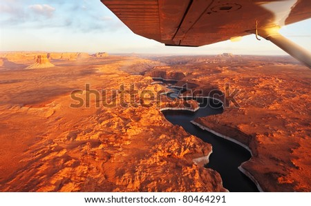 Magnificent lake Powell  and canyon Antelope on a sunset photographed from the plane. - stock photo