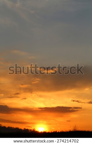 magnificent landscape with sunset over the field - stock photo