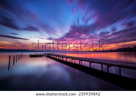 Magnificent long exposure lake sunset - stock photo
