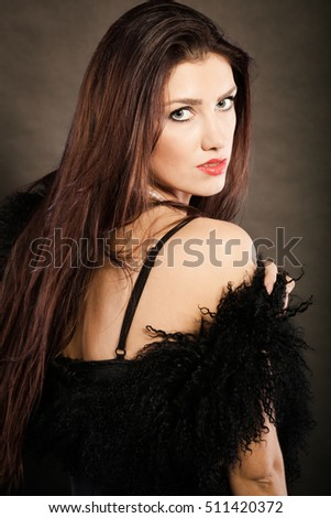 Magnificent long hair woman red lipstick black dress portrait on dark