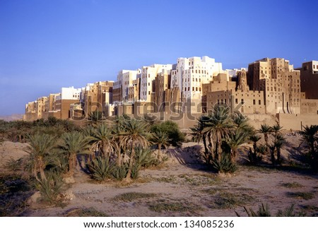 Magnificent morning light at the skyscrapers of the city of Shibam in Yemen. This city is situated in the middle of the Hadramaut valley, which is an UNESCO World Heritage site. - stock photo