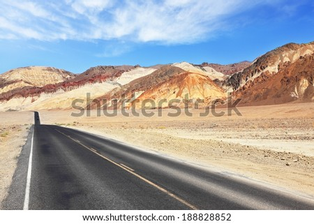 Magnificent quality of the American roads. A straight line as an arrow the well-groomed and smooth road in the dry and wild Death Valley Desert