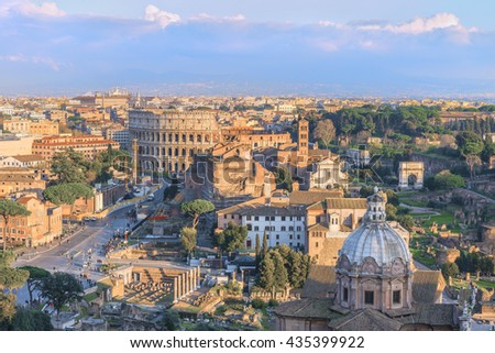 Magnificent Roman Forum and Great Colosseum ( Coliseum, Colosseo,Flavian Amphitheatre ),at sunset time.Picturesque urban landscape.Aerial panoramic view on famous touristic landmark.Rome.Italy.Europe. - stock photo