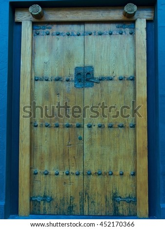 Magnificent Stately Textured Oak Door with Ornate Oriental Metal Detailing. - stock photo