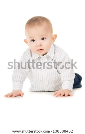 magnificent the child in clothes crawling on the floor isolated on white background - stock photo