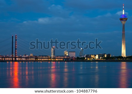 Magnificent view of night Dusseldorf. GPS information is in the file - stock photo