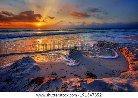 Magnificently colorful beach vacation sunrise 3 - stock photo
