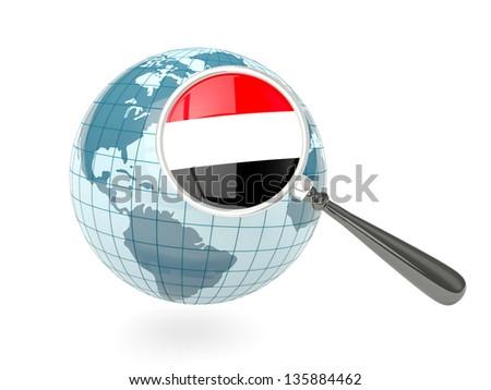 Magnified flag of yemen with blue globe isolated on white - stock photo