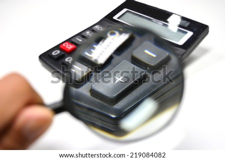 Magnifier and calculator - stock photo