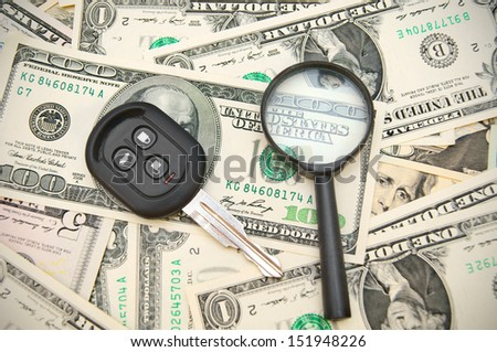 Magnifier and keys from the car. - stock photo