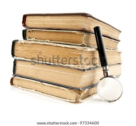 magnifier and old books on a white background - stock photo