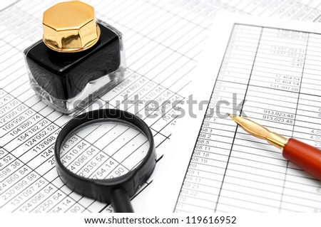 Magnifier, Pen and ink on documents. - stock photo
