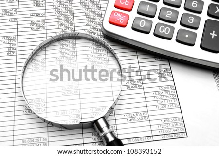 Magnifier, the calculator and documents. - stock photo