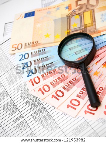 Magnifiers and denomination euro on documents. - stock photo