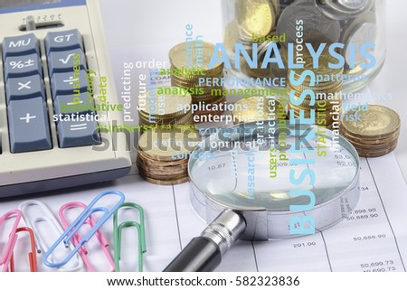 Magnify glass,coins and calculator. Business concept.