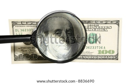 Magnifying glass and banknote of 100 dollars isolated on white background