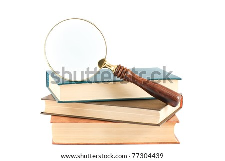 Magnifying glass and books isolated on white background - stock photo