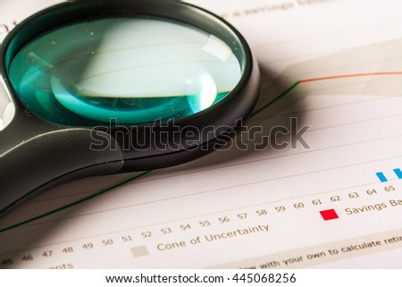 Magnifying glass and business growth graph